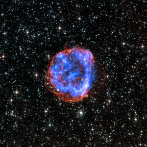 Los restos de una estrella que ha explotado en forma de supernova. Crédito: X-ray: NASA/CXC/Rutgers/J.Hughes; Optical: NASA/STScI
