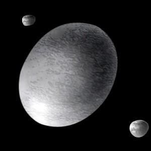 Recreación de Haumea (un planeta enano) y sus dos satélites. Crédito: A. Feild (Space Telescope Science Institute)