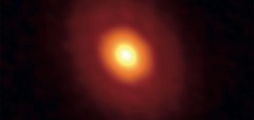 En esta imagen se puede ver, resaltada en naranja, la linea de congelamiento de V883 Orionis. Crédito: Cieza, L.A. et al. Nature